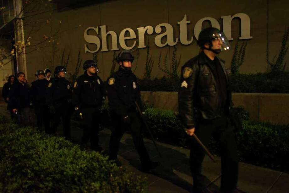 Seattle Police officers march around the Sheraton Hotel during an Occupy Seattle protest. Photo: JOSHUA TRUJILLO / SEATTLEPI.COM