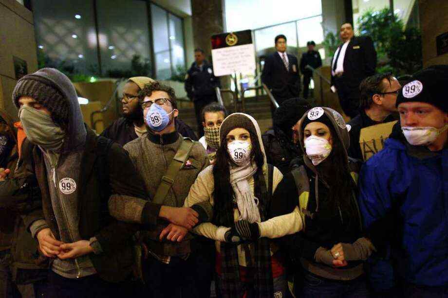 Protesters try to block access to the Sheraton Hotel. Photo: JOSHUA TRUJILLO / SEATTLEPI.COM