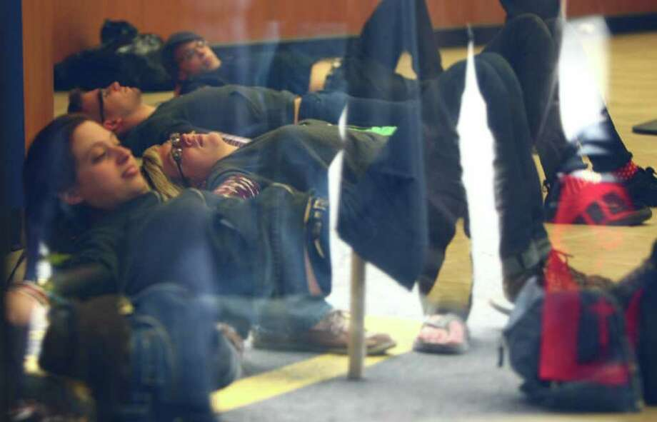 Protesters are locked together inside a Chase Bank during an Occupy Seattle protest on Broadway Avenue East and East Thomas Street on Wednesday. Photo: JOSHUA TRUJILLO / SEATTLEPI.COM
