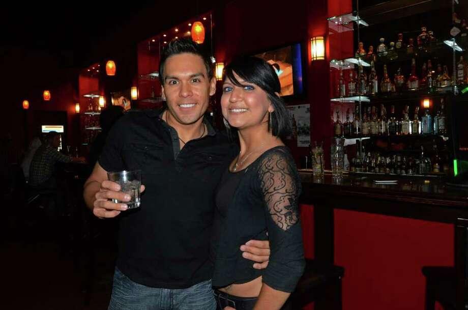 Regular Enrique Vasquez drinks with his favorite bartender Bianca Munoz at Red Square Bar on October 20, 2011. Robin Johnson