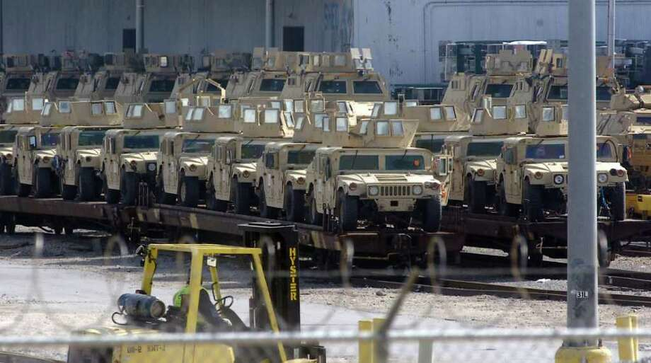 Military equipment can be seen loaded up and ready for transport just past the main gate of the Port of Beaumont Wednesday morning. Dave Ryan/The Enterprise Photo: Dave Ryan