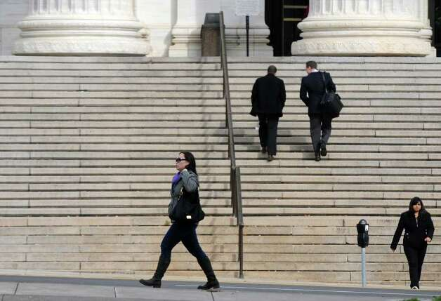 Pedestrians walk along Washington Avenue and up the stairs to the state Education building on Thursday  Nov. 3, 2011 in Albany, NY.   (Philip Kamrass / Times Union ) Photo: Philip Kamrass / 00015277A