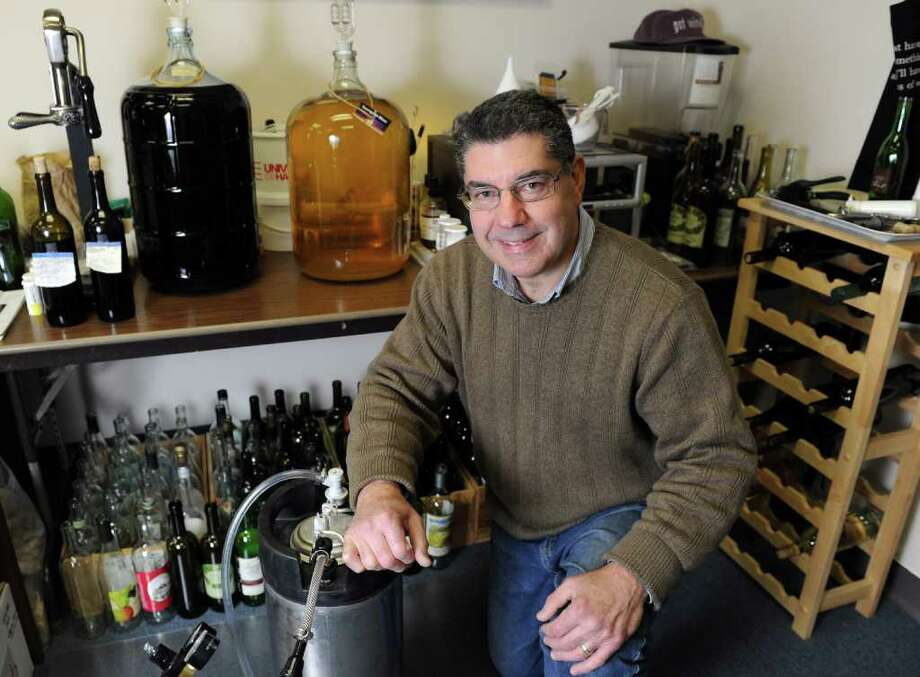 Tony Testa poses with a Cornelius keg (corny keg) used for beer making and some of his wine making supplies at his shop, A Wine and Beer Maker's Cellar, at 52 Bridge St. in Ansonia, Conn. Photo: Autumn Driscoll / Connecticut Post