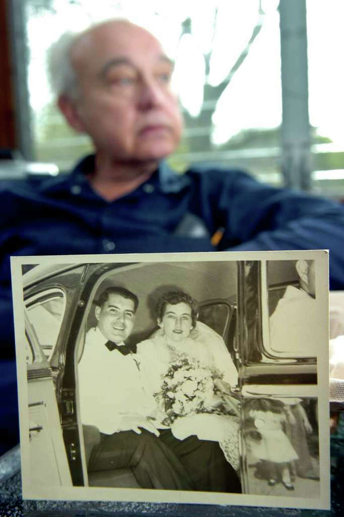 William Jarvis with a 1950 wedding day photo of his parents, George and Ruth Jarvis, as he sits in their Seymour, Conn. home Nov. 3rd, 2011. William's parents both passed away this week, just a day apart. Ruth died Sunday, and George died on Monday.