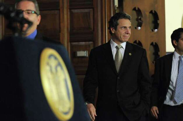Gov. Andrew Cuomo walks into the Red Room from his office to discuss PEF workers voting in favor of the state's contract proposal, thereby avoiding layoffs, in the Capitol on Thursday  Nov. 3, 2011 in Albany, NY.  (Philip Kamrass / Times Union ) Photo: Philip Kamrass / 00015277A