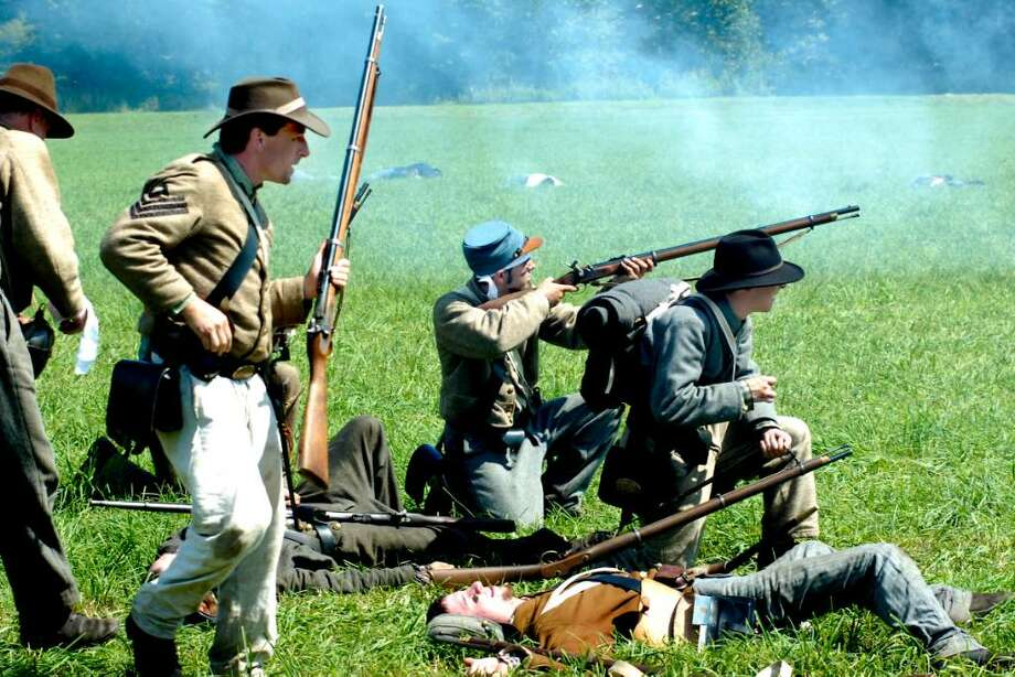 Confederate forces advance on the battlefield, despite heavy loses, during the Battle of 3rd Winchester in a Civil War Reenactment of the Battle for the Shenandoah Valley at Three Rivers Park in Woodbury on saturday. Photo: Michael Duffy / The News-Times