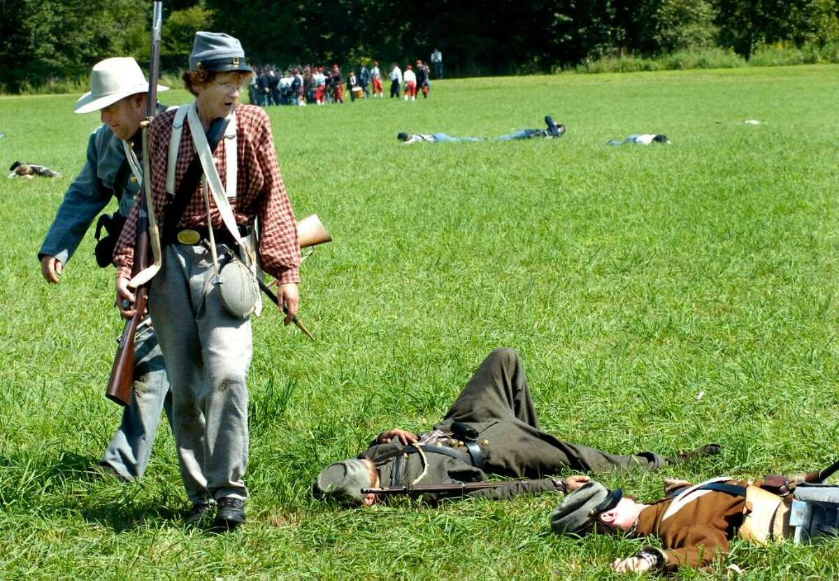 Confederate forces pull back on the battlefield, after heavy loses, during the Battle of 3rd Winchester in a Civil War Reenactment of the Battle for the Shenandoah Valley at Three Rivers Park in Woodbury on saturday.