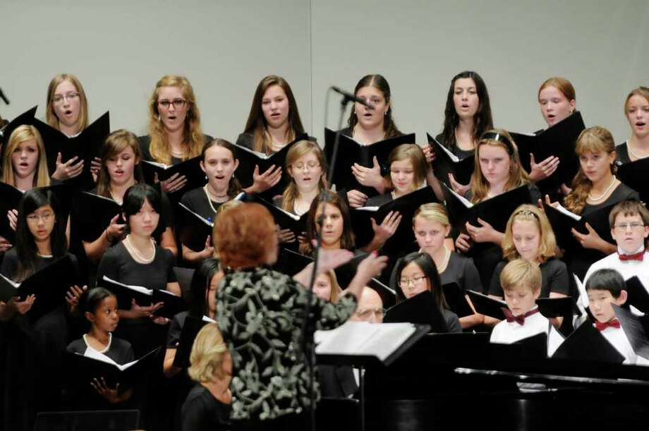 Members of the Capital District Youth Chorale perform during The Capital District Sings! event at Proctors on Sunday, Oct. 9, 2011 in Schenectady.  The event is part of the MoHu festival.  (Paul Buckowski / Times Union) Photo: Paul Buckowski / 00014910A