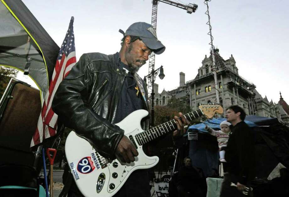 Chief Joseph Woods plays guitar at the Occupy Albany encampment at Academy Park in Albany , NY Tuesday, Nov.1, 2011.( Michael P. Farrell/Times Union) Photo: Michael P. Farrell
