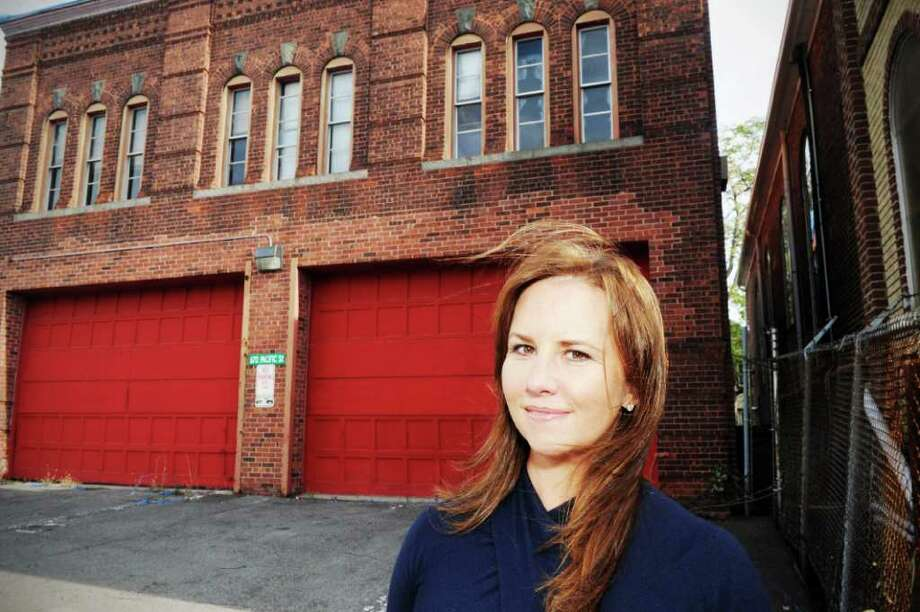 Pamela Jimenez outside the Pacific Street firehouse in Stamford, Conn., November 3, 2011. Jimenez is contemplating buying the site and converting it to a studio for her interior design firm Pamela Jimenez Design. Photo: Keelin Daly / Stamford Advocate