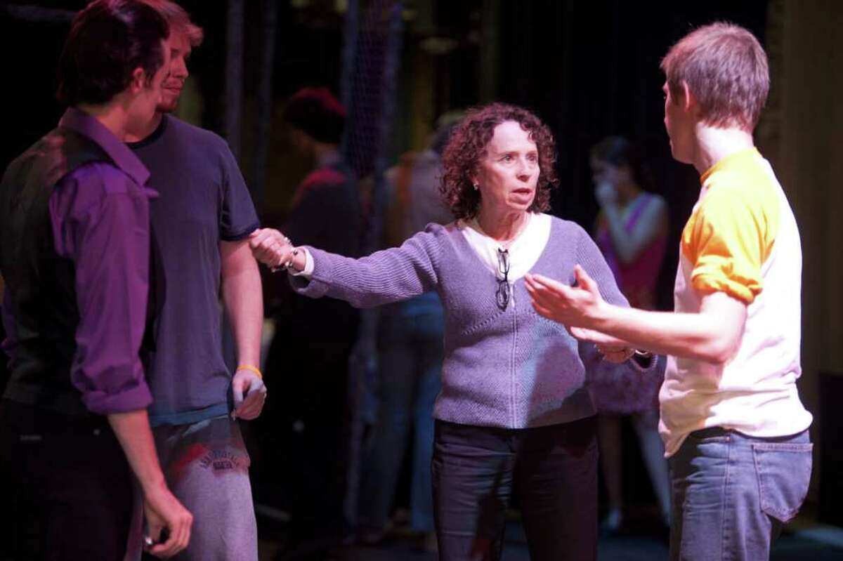 """Joanne Kahn instructs a trio of dancers during a rehearsal for the Staples Players' production of """"West Side Story."""" When the show closes later this month, Kahn plans to retire after 22 years as choreographer for the high school theater group. The show opens its six-performance run Friday evening, Nov. 11."""