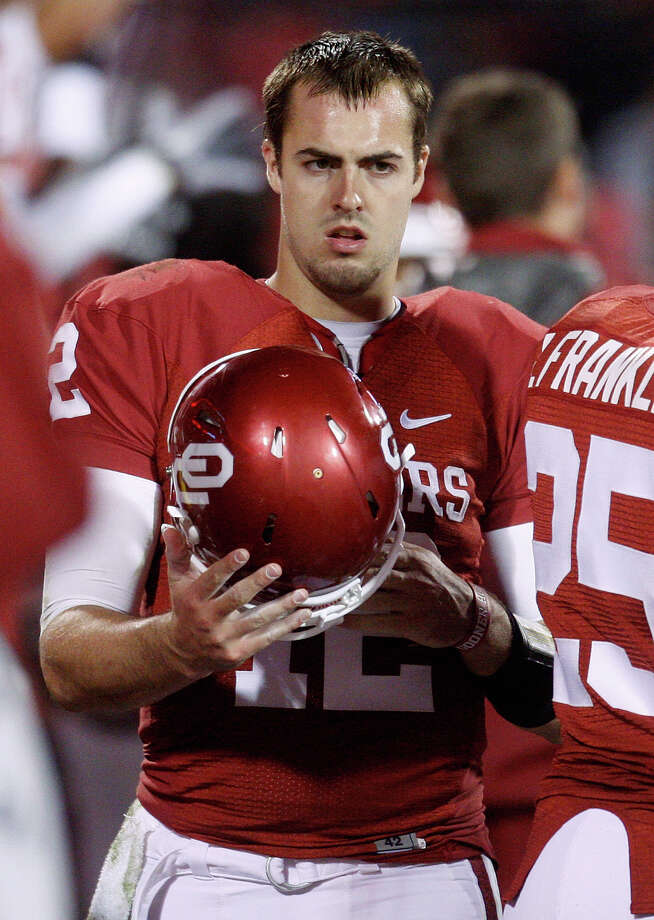 Oklahoma quarterback Landry Jones walks along the Oklahoma bench late in the fourth quarter of an NCAA college football game against Texas Tech in Norman, Okla., Saturday, Oct. 22, 2011. Texas Tech won 41-38. Photo: Sue Ogrocki, Associated Press / AP