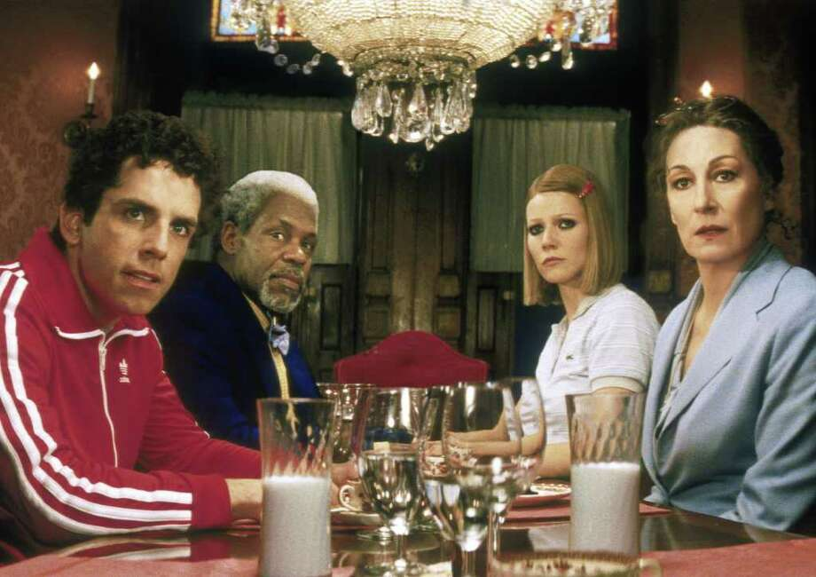 ADVANCE FOR WEEKEND EDITIONS DEC. 13-16--THE ROYAL TENENBAUMS--Cast members of Touchstone Pictures 'The Royal Tenenbaums,' appear in this promotional photo. The ensemble film about a family of failed geniuses may have a shot at an Oscar. From left, are Ben Stiller, Danny Glover, Gywneth Paltrow, and Anjelica Huston at the Tenenbaum dinner table. (AP Photo/Touchstone Pictures) / TOUCHSTONE PICTURES