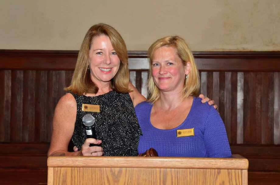 Patsy Devine of Fairfield, immediate past president of Near & Far Aid, left, welcomes incoming president Jeanne Burris of Westport. Photo: Contributed Photo