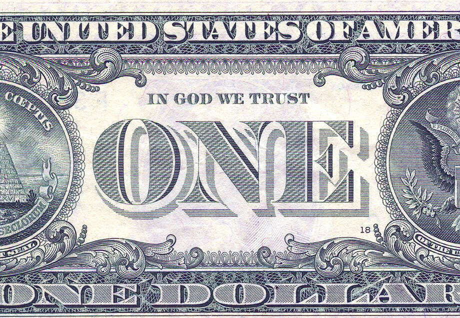 "Scan of detail of U.S. $1 bill featuring national motto, ""In God We Trust.""  ONE DOLLAR BILL / handout"
