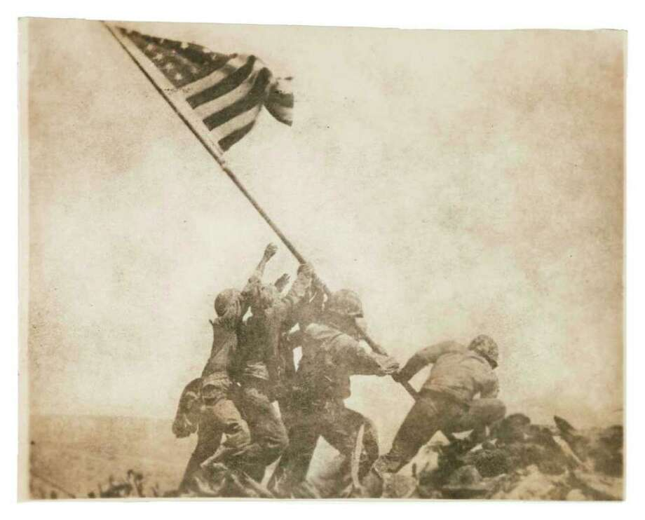 MUSEUM OF FINE ARTS, HOUSTON GENRE: Joe Rosenthal's famous 1945 photo from Iwo Jima was the seed of the idea for an MFAH exhibition of war photography, to debut next Veterans Day. Photo: AP/Wide World Photos