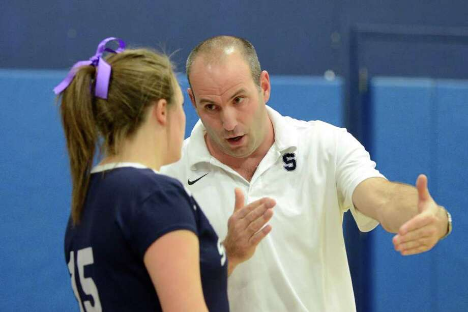 Staples coach Jon Shepro gives instructions as Staples High School hosts Stamford High School in girls volleyball in Westport, CT on Thursday, November 3, 2011. Photo: Shelley Cryan / Shelley Cryan freelance; Stamford Advocate freelance