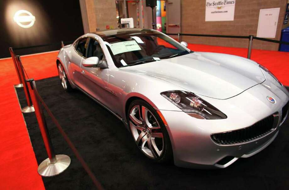 The Seattle Auto Show features the latest in electric cars, from compacts to super-cars like this 2012 Fisker Karma. The Karma, shown on Wednesday, November 2, 2011, features an all-electric stealth mode or fuel-assisted sport mode, has solar panels on the roof and costs $112,000. Before getting to other cars, here are a couple more angles on the Karma. The show runs through Sunday at CenturyLink Field Events Center. Photo: JOSHUA TRUJILLO / SEATTLEPI.COM