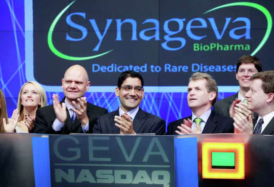 Sanj Patel, center, President and CEO of Synageva BioPharma Corp., attends the opening bell ceremony at Nasdaq with colleagues and guests, Thursday, Nov. 3, 2011 in New York. Synageva, based in Lexington, Mass., develops drugs for patients with life-threatening rare diseases. (AP Photo/Mark Lennihan) Photo: Mark Lennihan / AP