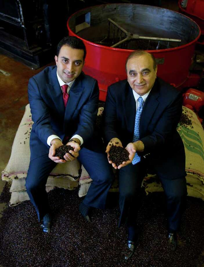 Cody Duty : Chronicle A BOUNTY OF BEANS: Fresh Brew Group President Ali Ansari, left, and his father, CEO Dari Ansari, create custom coffee blends for their customers. Photo: Cody Duty / © 2011 Houston Chronicle