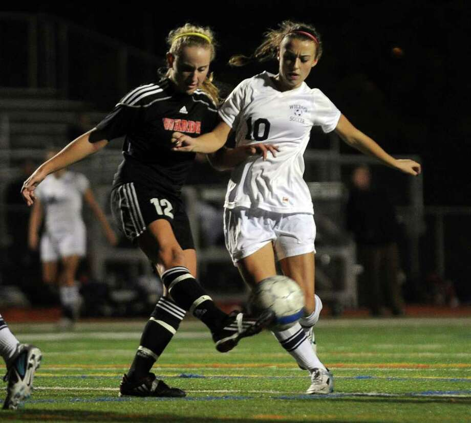 Fairfield Warde's #12 Maggie Allen, left, gets to the ball before Wilton's #10 Lindsay Knutson, during FCIAC girls' soccer semi-finals action in Norwalk, Conn. on Thursday November 3, 2011. Photo: Christian Abraham / Connecticut Post