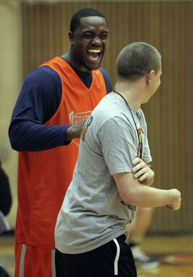 UTSA senior forward Larry Wilkins (left) shares a laugh with assistant Jeff Renegar at practice Thursday November 3, 2011. Wilkins suffered a season-ending injury during summer workouts but the team still voted the Madison grad as team captain. JOHN DAVENPORT/jdavenport@express-news.net Photo: Express-News