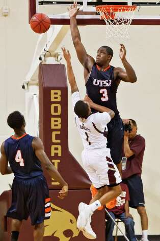 UTSA forward Larry Wilkins (right) fouls Texas State's Ryan White with 0.3 seconds remaining in their game and the game tied at 80-80 at Strahan Coliseum on Feb. 26, 2011.  White, with a game high 25 points, made the ensuing two free throws to propel the Bobcats to an 82-80 victory over the Roadrunners.  MARVIN PFEIFFER/mpfeiffer@express-news.net Photo: MARVIN PFEIFFER, Express-News / Express-News 2011