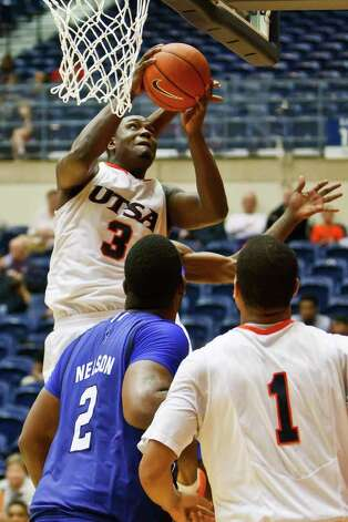 UTSA's Larry Wilkins puts up a shot under the basket during the second half of the Roadrunners 71-62 victory over Texas A&M - Corpus Christi at the UTSA Convocation Center on Feb. 23 2011.  MARVIN PFEIFFER/mpfeiffer@express-news.neti Photo: Express-News