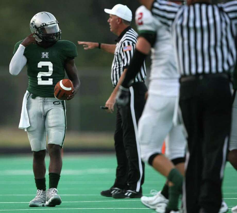 Hightower quarterback Bralon Addison (2) jestures to his teammates after Hightower incurred a false start penalty during the first half of their game, Friday at Hall Stadium in Missouri City. Photo: Eric Christian Smith