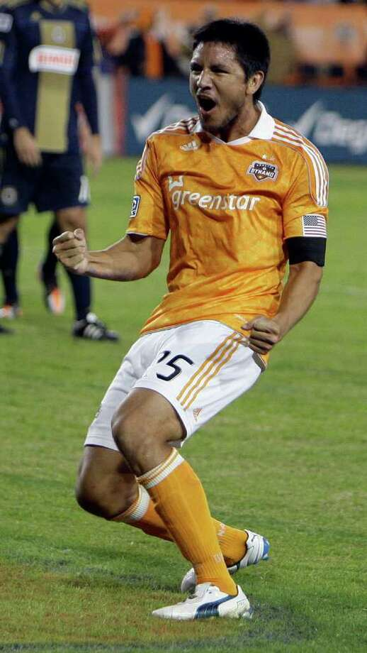 Houston Dynamo Brian Ching celebrates his goal. Photo: Melissa Phillip, Houston Chronicle / © 2011 Houston Chronicle