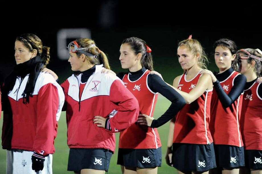 The New Canaan girls field hockey team at the start of the FCIAC girls semi-final field hockey match between New Canaan High School and Wilton High School at New Canaan High School, Thursday night, Nov. 3, 2011. Photo: Bob Luckey, Greenwich Time / Greenwich Time