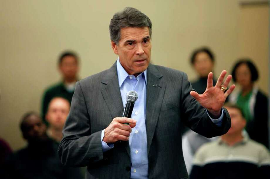 Republican presidential candidate Texas Gov. Rick Perry speaks during a town hall meeting with employees at Pioneer Hi-Bred, Thursday, Nov. 3, 2011, in Johnston, Iowa. (AP Photo/Charlie Neibergall) Photo: Charlie Neibergall