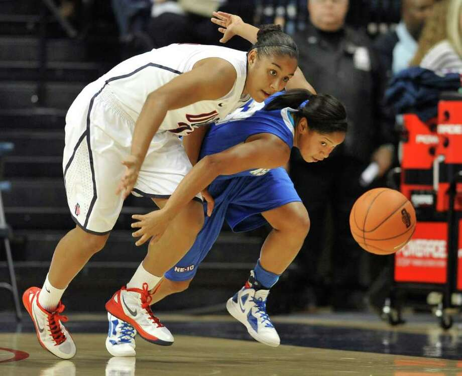 UConn's Kaleena Mosqueda-Lewis, left, and Assumption's Gabrielle Gibson chase down a loose ball in the first half of an exhibition game Thursday in Storrs. Photo: Jessica Hill/Associated Press / AP2011