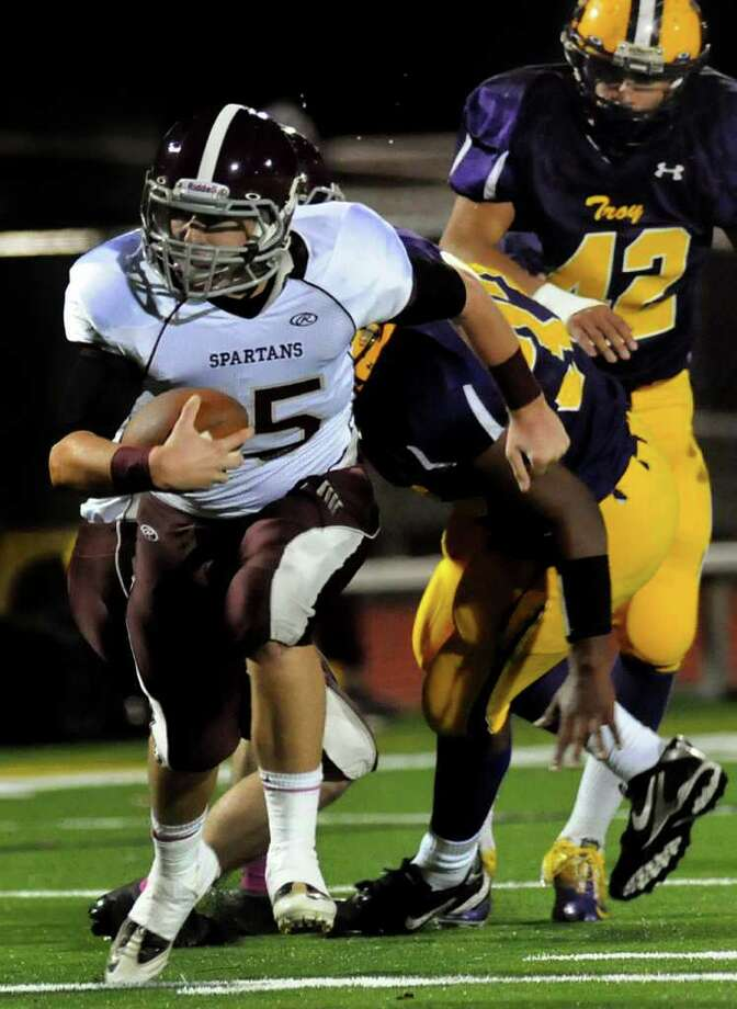 Burnt Hills' quarterback Ryan McDonnell (15), left, runs the keeper during their Class A semifinal football game on Friday, Oct. 27, 2011, at Troy High in Troy, N.Y. (Cindy Schultz / Times Union) Photo: Cindy Schultz / 00015096A