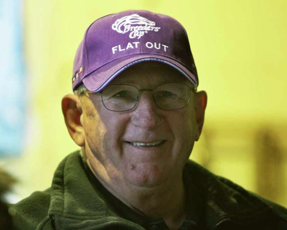 THIS CORRECTS THE TRAINERS NAME TO SCOOTER DICKEY - Trainer  Scooter Dickey has plenty to smile about with Breeders Cup Classic hopeful Flat Out in his barn at Churchill Downs in Louisville, Ky., Thursday, Nov. 3, 2011. (AP Photo/Garry Jones) Photo: Garry Jones