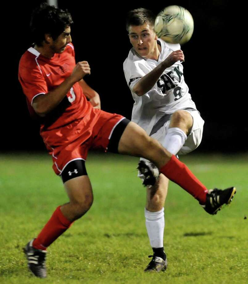 Shenendehowa's Adam Barlow (9), right, kicks the ball as Guilderland's Michael Crupi (3) defends during their Class AA Semifinal soccer game on Thursday, Nov. 3, 2011, at Colonie High in Colonie, N.Y. (Cindy Schultz / Times Union) Photo: Cindy Schultz / 00015236A