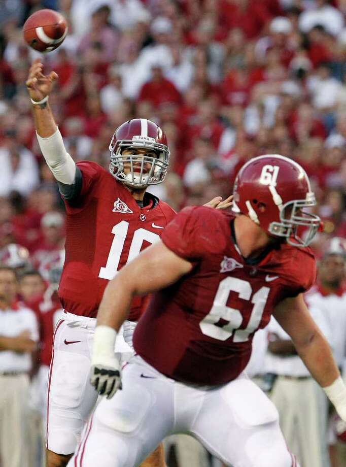 FILE - In this Oct. 8, 2011, file photo, Alabama quarterback AJ McCarron (10) looks for a receiver as offensive linesman Anthony Steen (61) blocks in the first half of an NCAA college football game at Bryant-Denny Stadium in Tuscaloosa, Ala. Second-ranked Alabama are slated to host No. 1 LSU on Saturday, Nov. 5, 2011. (AP Photo/Dave Martin, File) Photo: Dave Martin / AP2011
