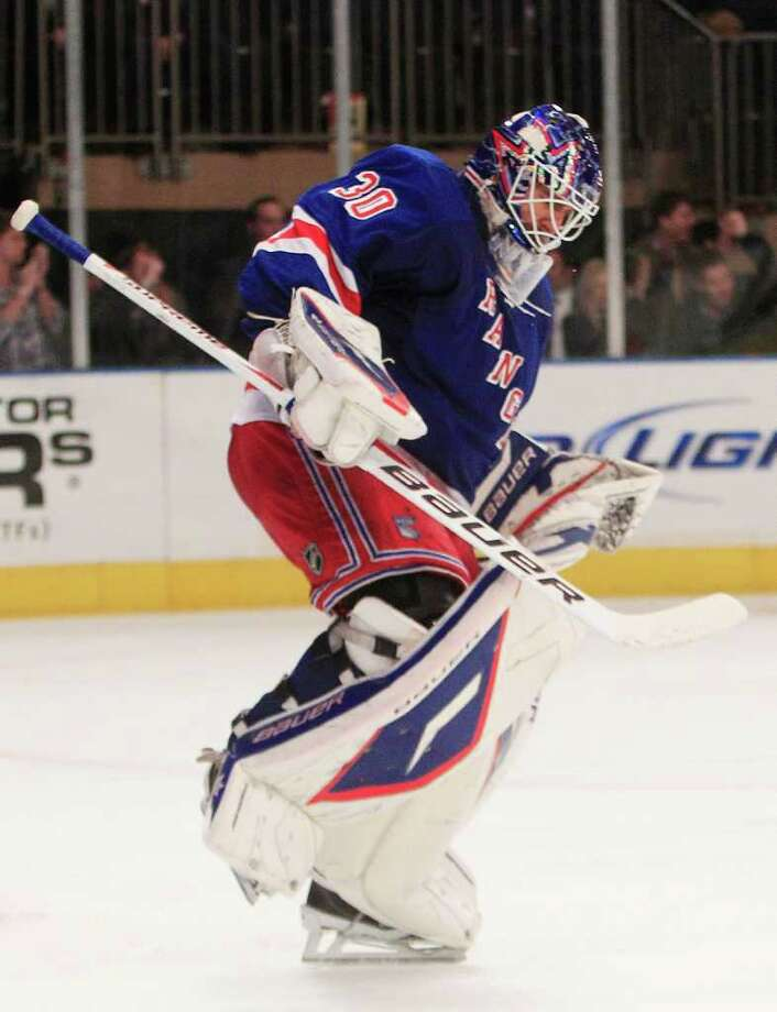New York Rangers goalie Henrik Lundqvist (30), of Sweden, reacts after blocking a shot to win the game in a shootoutduring an NHL hockey game against the Anaheim Ducks, Thursday, Nov. 3, 2011, in New York. The Rangers won 2-1. (AP Photo/Frank Franklin II) Photo: Frank Franklin II