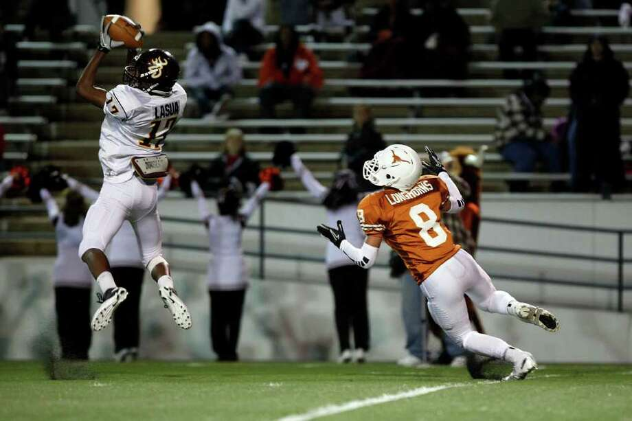 TODD SPOTH: FOR THE CHRONICLE PICKED CLEAN: Deer Park defensive back D.J. Lasua, left, leaps in front of Dobie's intended receiver to make a first-half interception Thursday at Pasadena Veterans Stadium. Photo: TODD SPOTH / Todd Spoth