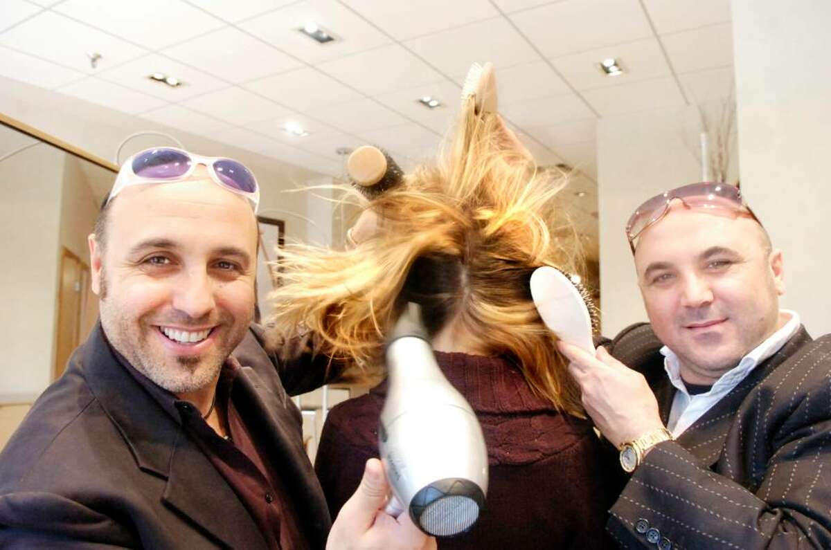 Piero, left, and Luigi Pirri photographed in the Pirri salon on Greenwich Avenue, Oct. 20, 2009. Their Pirri International Hair Group has added proprietary haircare tools manufactured in their native Italy to its product line Pirri Elements. The luxury products include paddle and round brushes and a hair dryer.