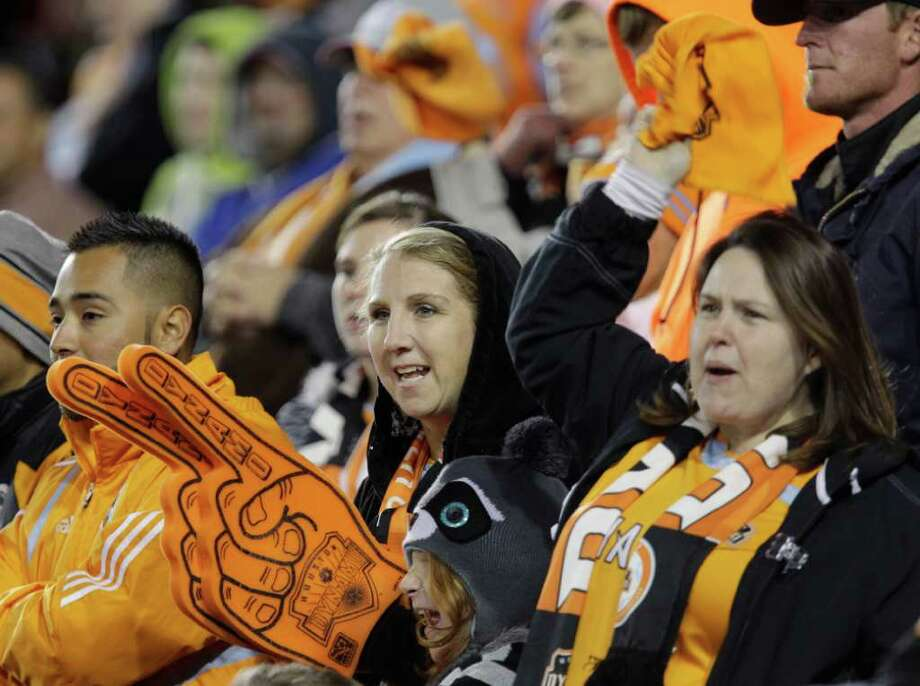 Houston Dynamo fans cheer on the team during final minutes of game against Philadelphia Union in MLS playoff series at Robertson Stadium, Thursday, Nov. 3, 2011, in Houston. ( Melissa Phillip / Houston Chronicle ) Photo: Melissa Phillip / © 2011 Houston Chronicle