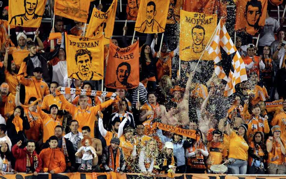 Dynamo fans celebrate the team's playoff victory over the Philadelphia Union on Thursday night at a raucous Robertson Stadium. Photo: Melissa Phillip / © 2011 Houston Chronicle