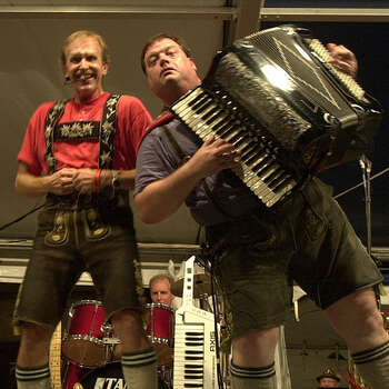 NEW BRAUNFELS:  The Sauerkrauts, featuring lead singer Franz (STAGE NAME SO NO LAST NAME), and the camera-hungry Robert Atwood , of Oklahoma City, on accordion, perform Friday, Nov. 2, 2001 during Wurstfest 2001. (KAREN L. SHAW/STAFF)  lede Photo: KAREN L. SHAW, SAN ANTONIO EXPRESS-NEWS