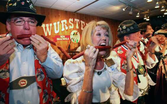 METRO   Al Leach (left) and Jerri Brumbelow lay into the ceremonial first bite of wurst to start the annual Wurstfest celebration in New Braunfels  October 30, 2009. Photo: TOM REEL, SAN ANTONIO EXPRESS-NEWS / treel@express-news.net