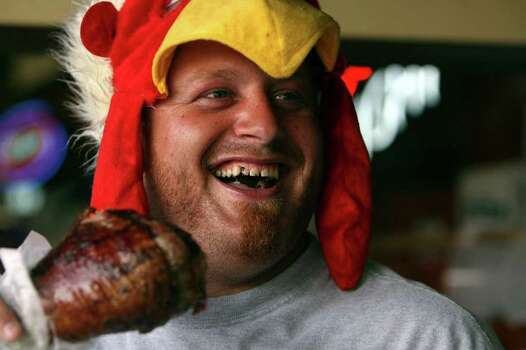 Kyle Howe of Oklahoma City enjoys a turkey leg Sunday in New Braunfels during Wurstfest. JOHN DAVENPORT/jdavenport@express-news.net Photo: JOHN DAVENPORT, SAN ANTONIO EXPRESS-NEWS / jdavenport@express-news.net