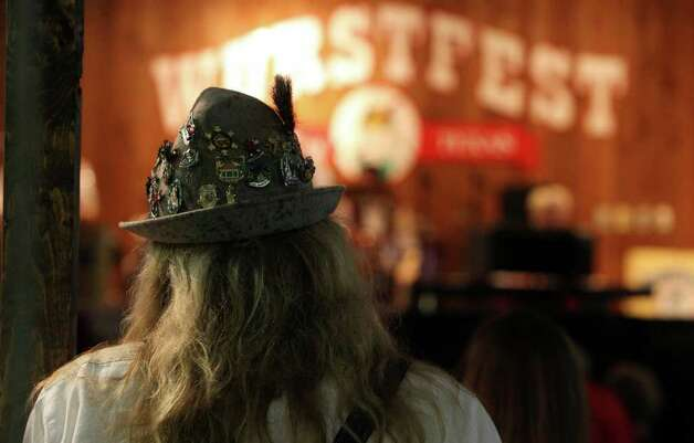 Ernest Moore of Converse, Texas watches music and dancing at Wurstfest in New Braunfels Sunday. JOHN DAVENPORT/jdavenport@express-news.net Photo: JOHN DAVENPORT, SAN ANTONIO EXPRESS-NEWS / jdavenport@express-news.net