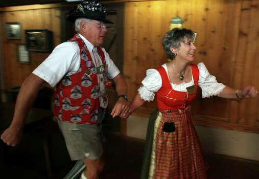 Bill Holden (L) and Barbara Holden of the Wurstfest Association show the circling to the right part of the Chicken Dance. (For ASF/ Roger Croteau) JOHN DAVENPORT/jdavenport@express-news.net Photo: JOHN DAVENPORT, SAN ANTONIO EXPRESS-NEWS / jdavenport@express-news.net