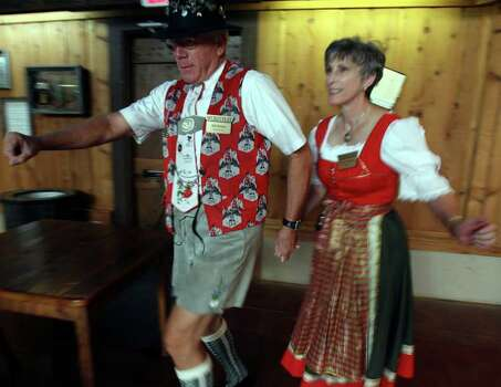 Bill Holden (L) and Barbara Holden of the Wurstfest Association show the circling to the left part of the Chicken Dance. (For ASF/ Roger Croteau) JOHN DAVENPORT/jdavenport@express-news.net Photo: JOHN DAVENPORT, SAN ANTONIO EXPRESS-NEWS / jdavenport@express-news.net