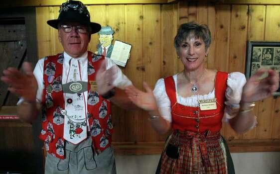 Bill Holden (L) and Barbara Holden of the Wurstfest Association illustrate the clapping part of the Chicken Dance. (For ASF/ Roger Croteau) JOHN DAVENPORT/jdavenport@express-news.net Photo: JOHN DAVENPORT, SAN ANTONIO EXPRESS-NEWS / jdavenport@express-news.net