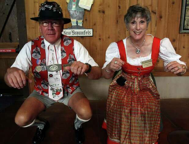 "Bill Holden (L) and Barbara Holden of the Wurstfest Association illustrate how to wiggle one's ""tailfeathers"" during that portion of the Chicken Dance. (For ASF/ Roger Croteau) JOHN DAVENPORT/jdavenport@express-news.net Photo: JOHN DAVENPORT, SAN ANTONIO EXPRESS-NEWS / jdavenport@express-news.net"